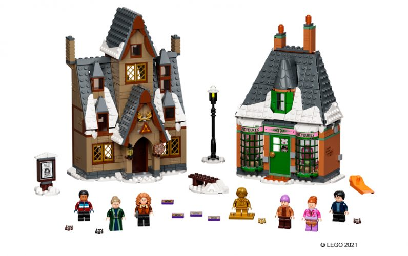 Zasneženi hiši iz Meryascoveene. V ospredju Dean Thomas, prof. McHudurra, Madam Rosmerta, gospa in gospod Flume ter Harry Potter