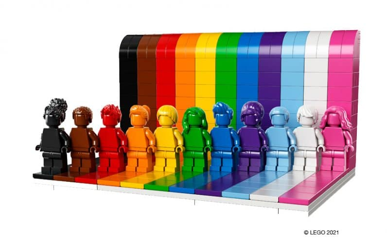 LEGO 40516 Everyone is Awesome minifigure v vrsti pred mavričnim zidom iz lego kock
