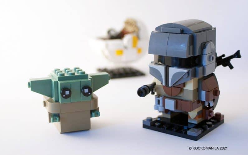 LEGO BrickHeadz Baby Yoda in Mandalorian. V ozadju voziček Baby Yode