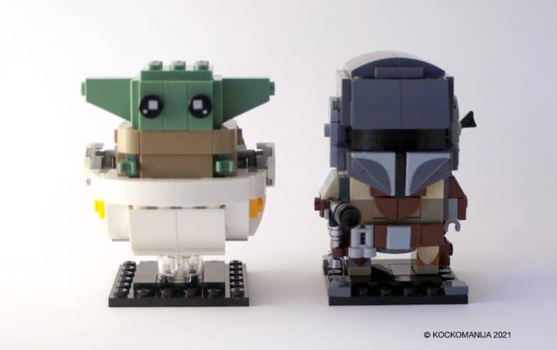 LEGO Brickheadz Baby Yoda v belem lebdečem vozičku poleg Mandaloriana.