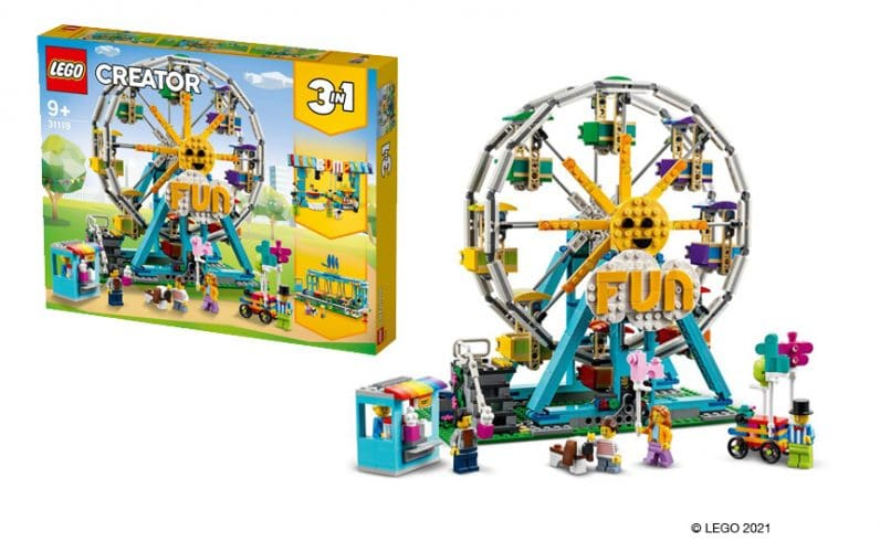 LEGO zabaviščno kolo. Zelo pisnao iz kock. Pred kolesom prodajalec balonov. V ozadju škatla Creator 3 v 1
