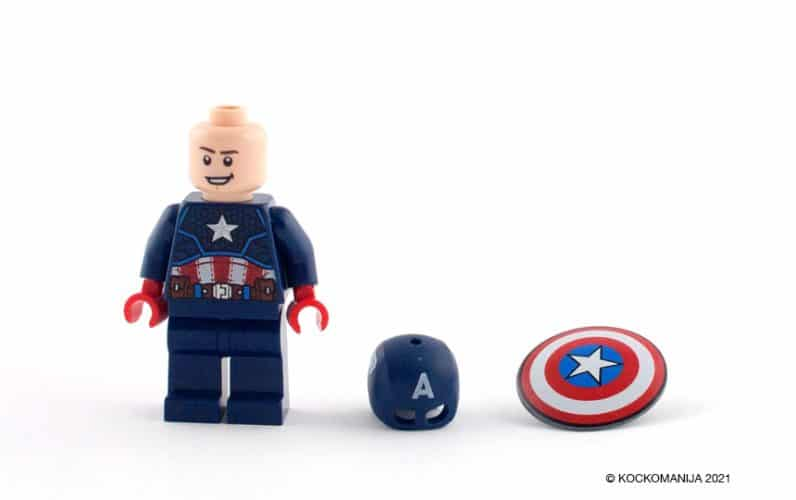LEGO 76168 Stotnik Amerika robotski oklep lego stotnik kapitan amerika z nasmejanim obrazom brez čelade na tleh poleg njega je čelada in ščit